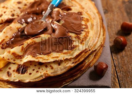 delicious crepe with creamy chocolate and spoon