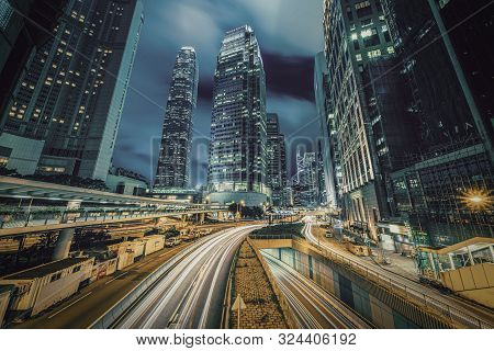 Long exposure of Hong Kong Cityscape skyscaper which have light traffic transportation from car or bus on Central Business District around IFC building, Hong Kong poster