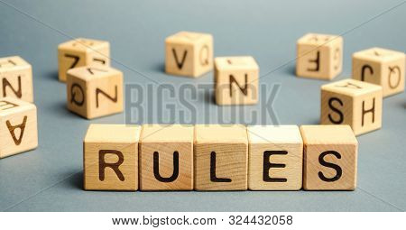Wooden Blocks With The Word Rules. Setting Rules, Laws. Legislation. Religious And Folk Traditions.