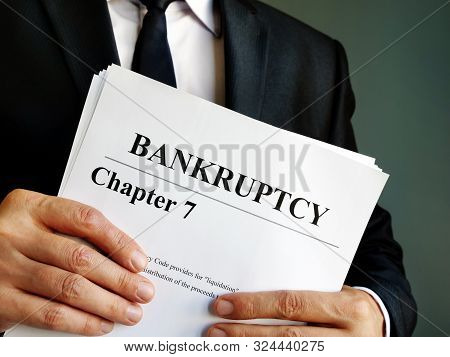 Bankruptcy Chapter 7 Stack Of Documents In The Hands.
