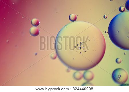 Oil Drops In Water. Defocused Abstract Psychedelic Pattern Image Red And Orange Colored. Abstract Ba