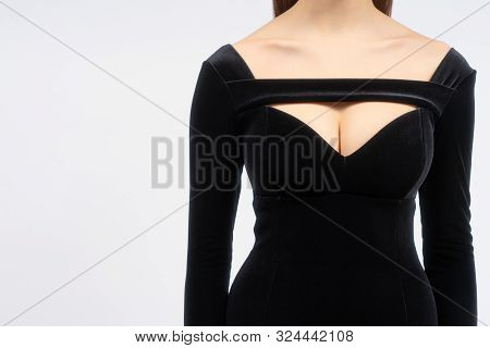 Beautiful shapes and collarbones with dress neckline. Attractive girl body on the white background. Copy space. poster