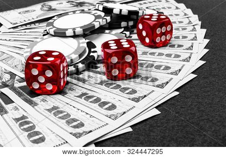 Stack Of Poker Chips With Dice Rolls On A Dollar Bills, Money. Poker Table At The Casino. Poker Game