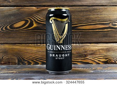 Helsinki, Finland, September 25, 2019: Aluminium Can Of Guinness Draught Stout Beer Bottle On Dark W