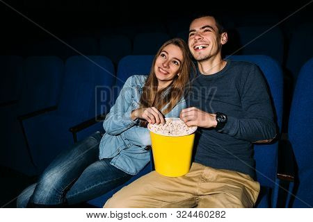 Cinema Day. Young Happy Couple Watching Funny Movie In Cinema At Their Romantic Date. World Cinema D