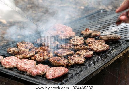 Meat On The Grill / Grilled Meatballs Fried On A Grid For Grilling Outdoors