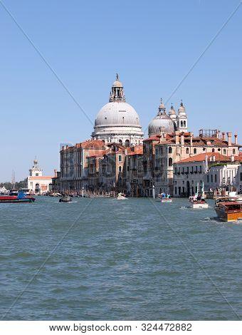 Dome Of Madonna Della Salute Church And Boats In Venice Italy