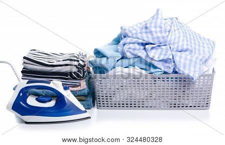 Basket With Folded Laundry And Stack Folded Clothing On White Background Isolation