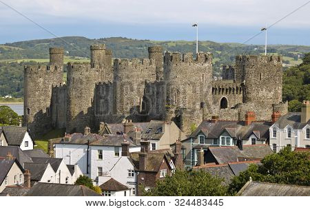 A View Of Conwy Castle Rising Above The Rooftops, The Castle A Major Tourist Draw To Conwy, Wales, G