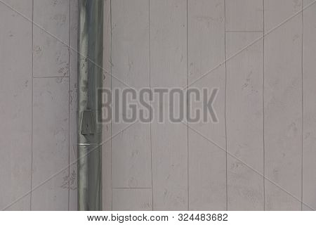 Closeup of gray striped beton wall with metal rainwater downpipe poster