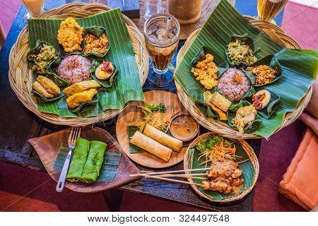 Nasi Lemak, Nasi Campur, Indonesian Balinese Rice With Potato Fritter, Sate Lilit, Fried Tofu, Spicy