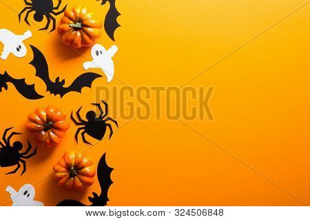 Happy Halloween Holiday Concept. Halloween Decorations, Spiders, Pumpkins, Bats, Ghosts On Orange Ba