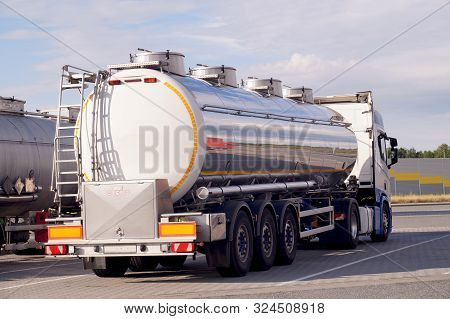 Tankers Parked In The Square. Transport Of Liquid And Loose Goods.