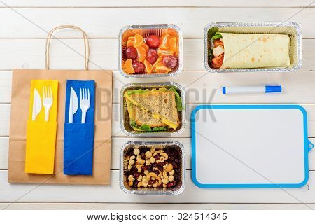Marker, A Dry Erase Board, Plastic Flatware And A Paper Bag, Nuts And Dried Fruit, Cheese And Lettuc