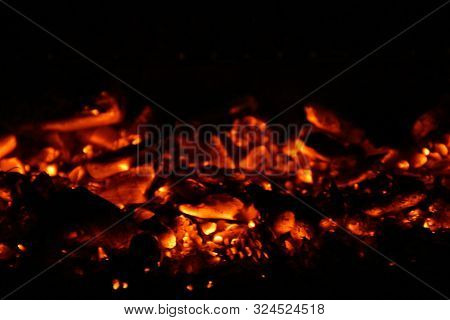 Burning Coal That Remains When The Burning Fuel Has Burned Away. Bright, Hot Embers. Hot And Bright