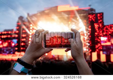 Using Camera Of Mobile Phone To Take Pictures And Videos At Outdoor Live Concert