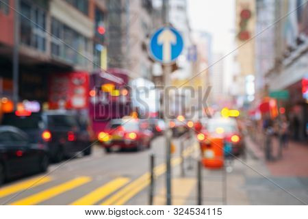 Abstract Light Blurred Car Trnsport With Road Signs In The Street, Hongkong