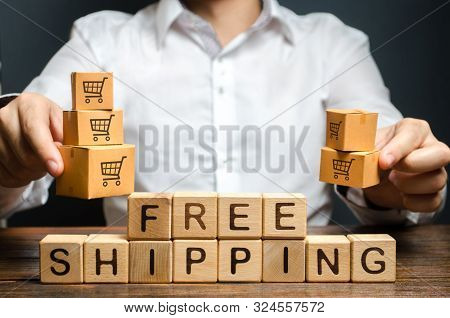 A Man Holds Boxes Over The Inscription Free Shipping. Promotions Preferential Terms For Large Custom