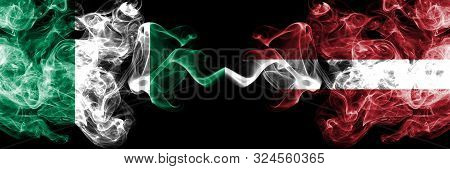 Nigeria Vs Latvia, Latvian Abstract Smoky Mystic Flags Placed Side By Side. Thick Colored Silky Smok