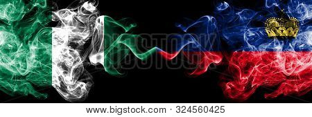 Nigeria Vs Liechtenstein, Liechtensteins Abstract Smoky Mystic Flags Placed Side By Side. Thick Colo