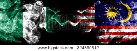 Nigeria Vs Malaysia, Malaysian Abstract Smoky Mystic Flags Placed Side By Side. Thick Colored Silky