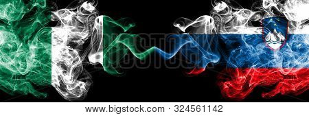 Nigeria Vs Slovenia, Slovenian Abstract Smoky Mystic Flags Placed Side By Side. Thick Colored Silky