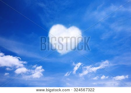 White Cloud In The Shape Of A Heart In The Blue Sky. Natural Shape Heart In The Sky With Clouds. Hea