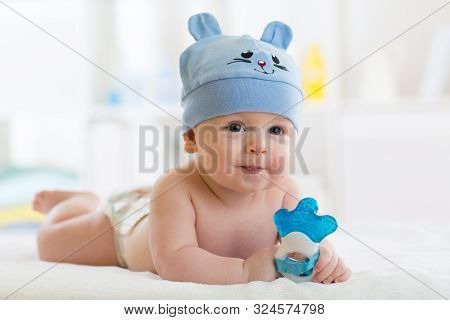 Baby Infant Weared Funny Hat And Diaper In Nursery Room