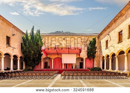 Pollenca, Mallorca, Spain, July 2015 Convent Claustre De Sant Domingo With Stage And Chairs Ready Fo