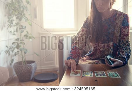 Budapest, Hungary. September 2019: Fortune Teller Forecasting The Future With Tarot Cards.