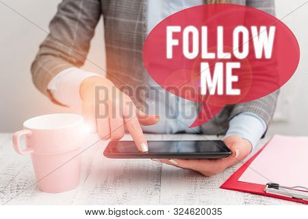 Text sign showing Follow Me. Conceptual photo Inviting a demonstrating or group to obey your prefered leadership Business woman sitting with mobile phone and cup of coffee on the table. poster