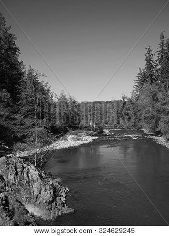 The Rocky And Rugged Shores Of The Middle Fork Of The Willamette River Near Oakridge Oregon Filled W