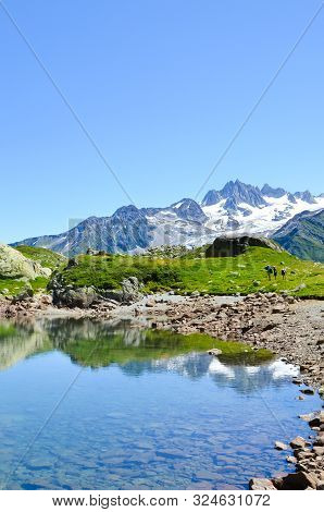Stunning Lac De Cheserys, Lake Cheserys Near Chamonix-mont-blanc In French Alps. Alpine Lake With Sn