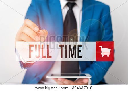 Word writing text Full Time. Business concept for working or operating the customary number of hours in a day Businessman pointing with pen in empty copy space. poster