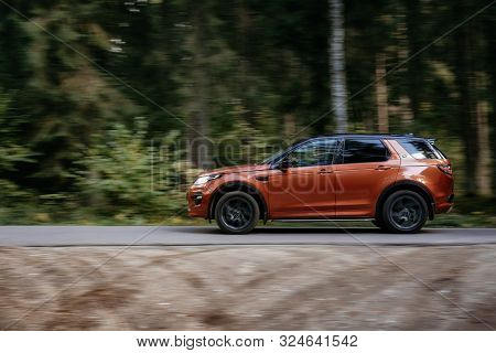 Minsk, Belarus - September 24, 2019: Borwn Color Car Land Rover Discovery Sport Fast Moving On Count