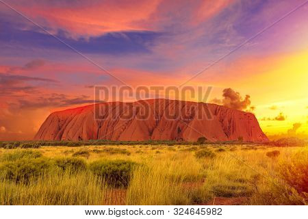 Uluru, Northern Territory, Australia - Aug 22, 2019: Colorful Clouds At Sunset Sky Over Ayers Rock I