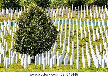 Potocari, Bosnia And Herzegovina - July 31, 2019. White Lines Of Gravestones As Memorial To Victims