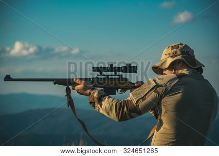 Hunter Classic. Hunter With Hunting Gun. Man Hunter With A Gun. Closed And Open Hunting Season. Man
