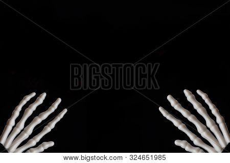 Skeletal Hands On Black Background With Copy Space, Death And Mistery Concept, Halloween