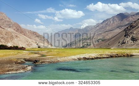 Panj River, Pamir And Hindukush Mountains. Panj Is Upper Part Of Amu Darya River. Panoramic View. Ta