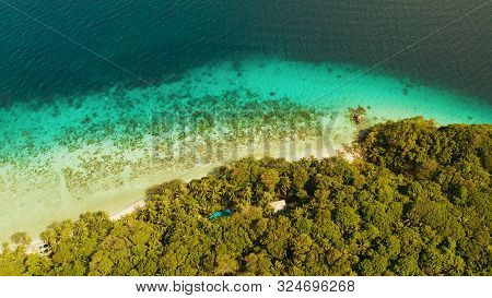 Coastline With Forest And Palm Trees, Coral Reef With Turquoise Water, Aerial View. Sea Water Surfac