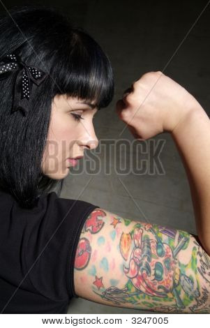 Woman With Tattoo And Fist