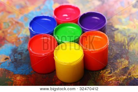 Close up of cans with colorful paint