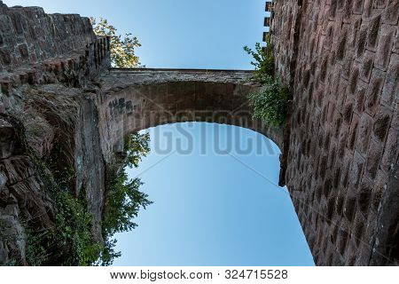 A Bridge Between Castle And Tower Made Of Red Sandstone