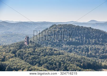 Big Hill With A Big Rock And The Green Forest