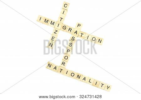 Immigration minimalistic concept. Isolated wooden letter blocks with word cloud citizen, passport and nationality poster