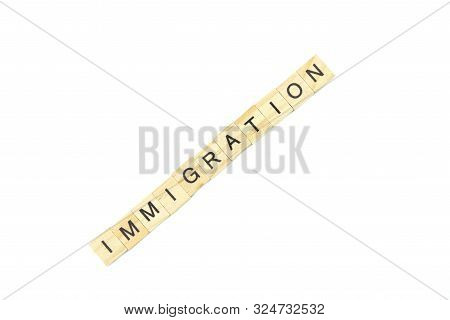 Immigration Minimalistic Concept. Isolated Wooden Letter Blocks With Word Cloud Immigration