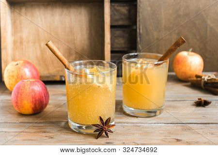 Spicy Apple Cider Drink. Seasonal Autumnal Homemade Apple Cider On Wooden Table.