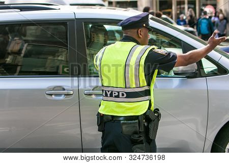 New York City, 9/27/2019: Police Officer Is Directing Traffic In The Streets Of Manhattan.