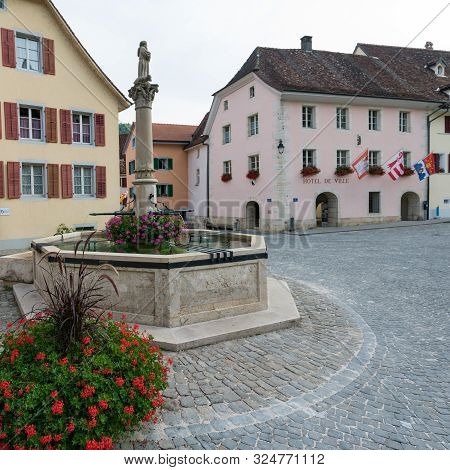 View Of The Town Square With The Town Hall And Fountain In The Historic Village Of Saint-ursanne